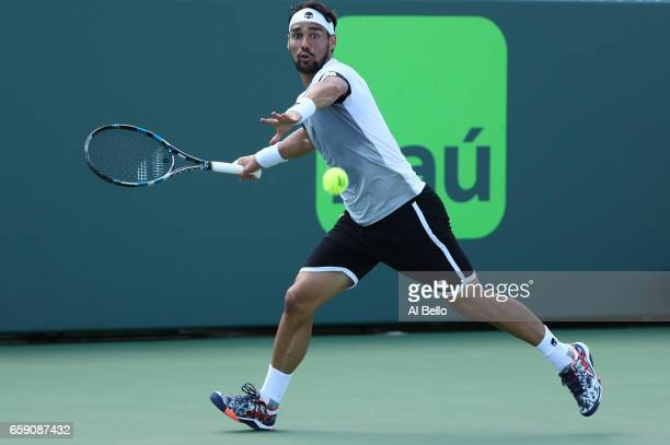 Fabio Fognini of Italy returns a shot against Donald Young during Day 9 of the Miami Open at Crandon Park Tennis Center on March 28 2017 in Key...