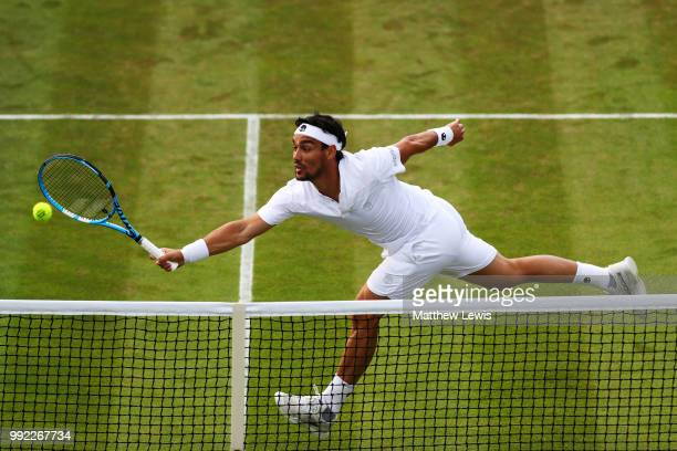 Fabio Fognini of Italy returns a shot against Simone Bolelli of Italy during their Men's Singles second round match on day four of the Wimbledon Lawn...