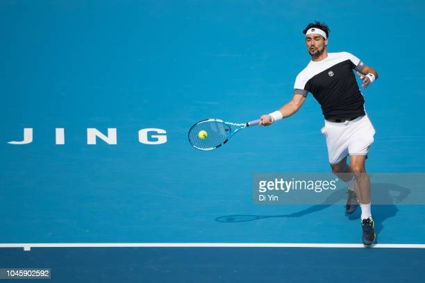 Fabio Fognini of Italy returns the ball against Marton Fucsovics of Hungary during his men's 1/4 final match of 2018 China Open at the China National...