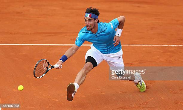 Fabio Fognini of Italy runs ro play a forehand volley against James Ward of Great Britain during day one of the Davis Cup World Group Quarter Final...