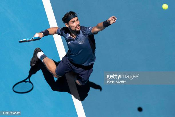 Fabio Fognini of Italy serves against Casper Ruud of Norway during their fifth session men's singles match on day three of the ATP Cup tennis...