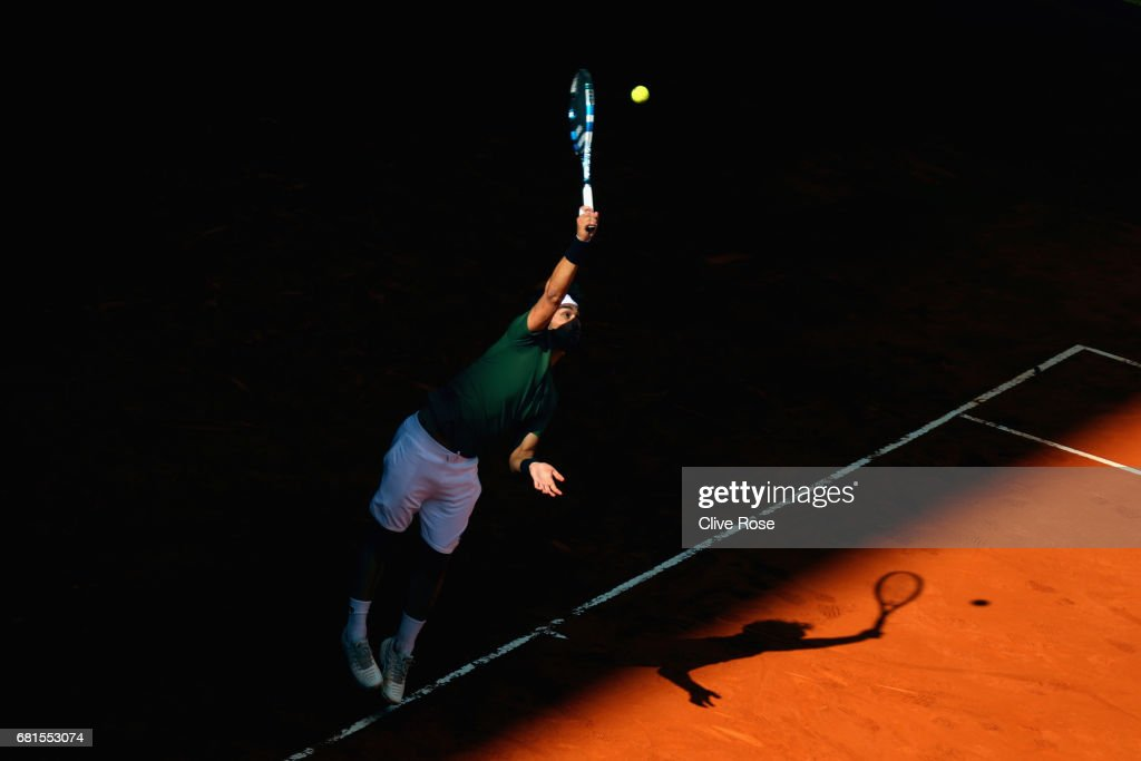 Fabio Fognini of Italy serves during his match against Rafael Nadal of Spain on day five of the Mutua Madrid Open tennis at La Caja Magica on May 10, 2017 in Madrid, Spain.