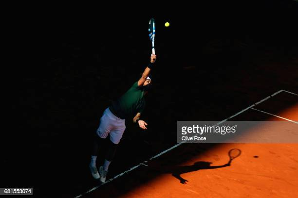 Fabio Fognini of Italy serves during his match against Rafael Nadal of Spain on day five of the Mutua Madrid Open tennis at La Caja Magica on May 10...