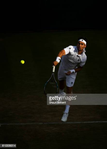 Fabio Fognini of Italy serves during the Gentlemen's Singles third round match against Andy Murray of Great Britain on day five of the Wimbledon Lawn...