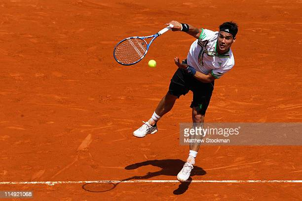 Fabio Fognini of Italy serves during the men's singles round four match between Fabio Fognini of Italy and Albert Montanes of Spain on day eight of...