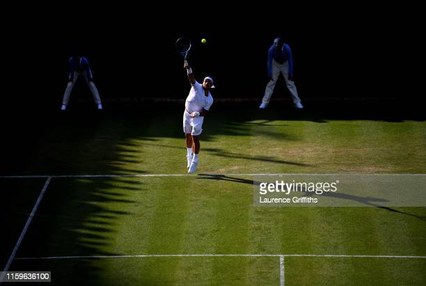 Fabio Fognini of Italy serves in his Men's Singles first round match against Frances Tiafoe of The United States during Day two of The Championships...