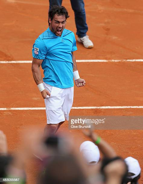 Fabio Fognini of Italy shakes celebrates to the crowd after his straight sets victory against Andy Murray of Great Britain during day three of the...