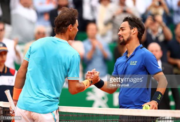 Fabio Fognini of Italy shakes hands at the net after his straight set victory against Rafael Nadal of Spain in their semifinal match during day seven...