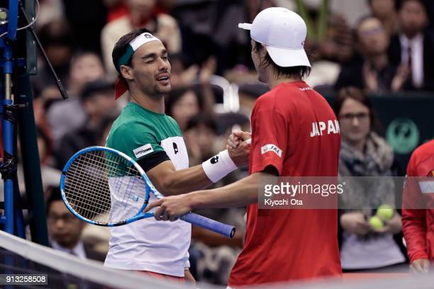 Fabio Fognini of Italy shakes hands with Taro Daniel of Japan after their singles match during day one of the Davis Cup World Group first round...