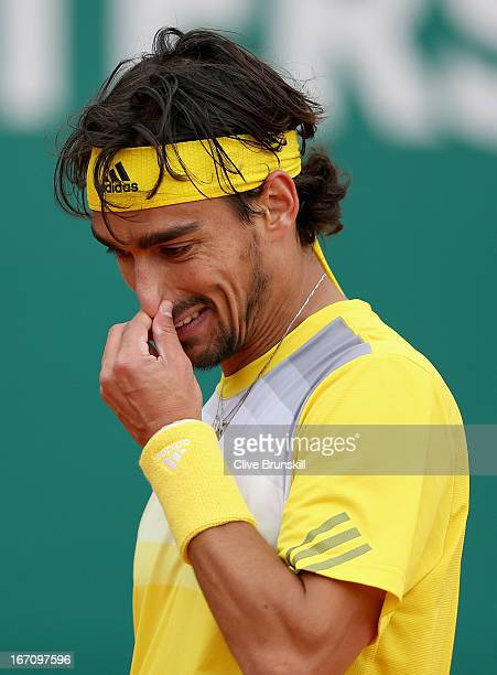 Fabio Fognini of Italy shows his emotions during his straight sets defeat against Novak Djokovic of Serbia in their semi final match during day seven...
