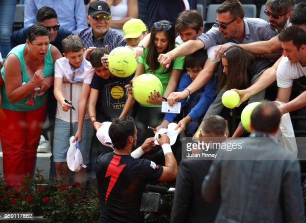 Fabio Fognini of Italy signs autographs after his win over Dominic Thiem of Austria during day four of the Internazionali BNL d'Italia 2018 tennis at...