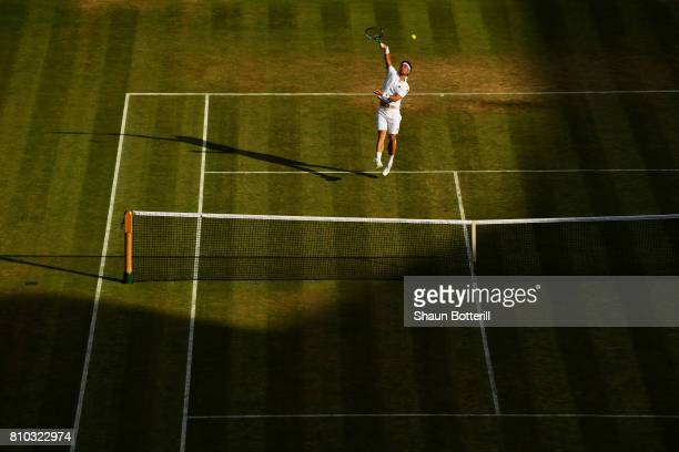 Fabio Fognini of Italy smashes the ball during the Gentlemen's Singles third round match against Andy Murray of Great Britain on day five of the...