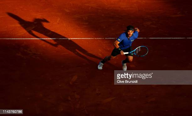 Fabio Fognini of Italy sprints for the ball against Borna Coric of Croatia in their quarter final match during day six of the Rolex Monte-Carlo...