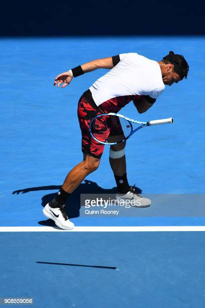 Fabio Fognini of Italy throws his racquet in frustration in his fourth round match against Tomas Berdych of the Czech Republic on day eight of the...