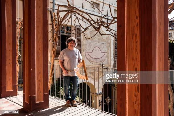 Fabio Garnero one of the last gnomonist in Italy poses for a picture in a Renaissance's mansion to restore an ancient sundial on April 17 2018 in...