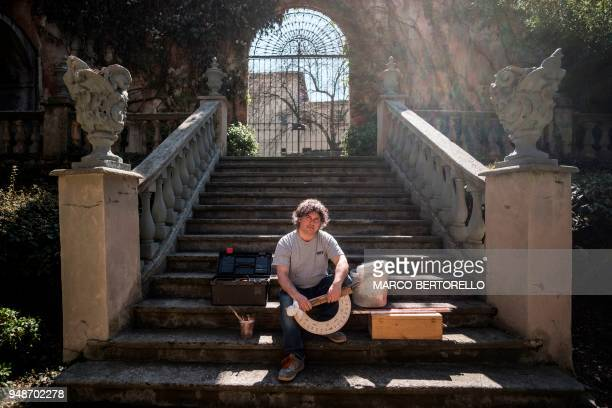 Fabio Garnero one of the last gnomonist in Italy poses for a picture in a Renaissance's mansion where he restores an ancient sundial on April 17 2018...