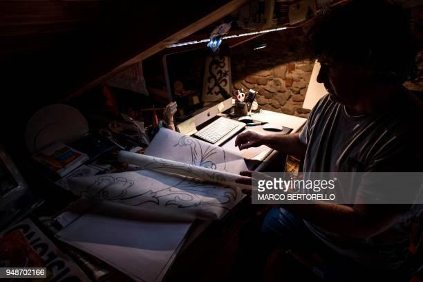 Fabio Garnero one of the last gnomonist in Italy studies a drawing for a sundial in his laboratory on April 17 2018 in Saluzzo near Turin Fabio...