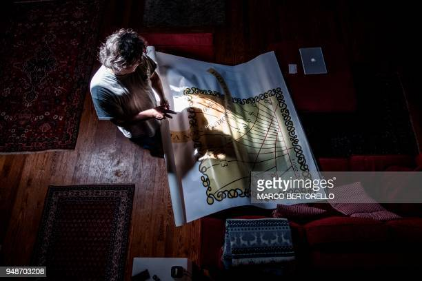 Fabio Garnero one of the last gnomonist in Italy studies a drawing for a sundial in his laboratory on April 17 2018 in Saluzzo near Turin Fabio...