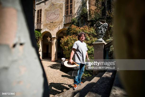 Fabio Garnero one of the last gnomonist in Italy works in a Renaissance's mansion to restore an ancient sundial on April 17 2018 in Saluzzo near...