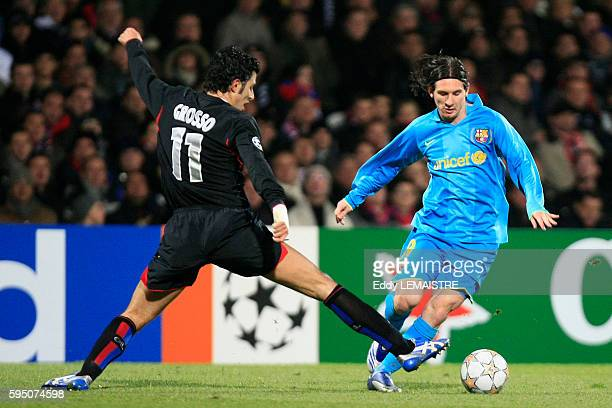 Fabio Grosso and Lionel Messi during the champions league soccer match between Olympique Lyonnais and FC Barcelona