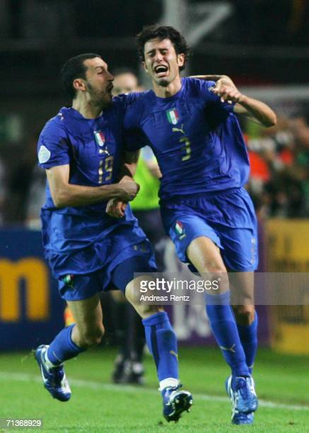 Fabio Grosso of Italy celebrates scoring his team's first goal in extra time with team mate Gianluca Zambrotta during the FIFA World Cup Germany 2006...