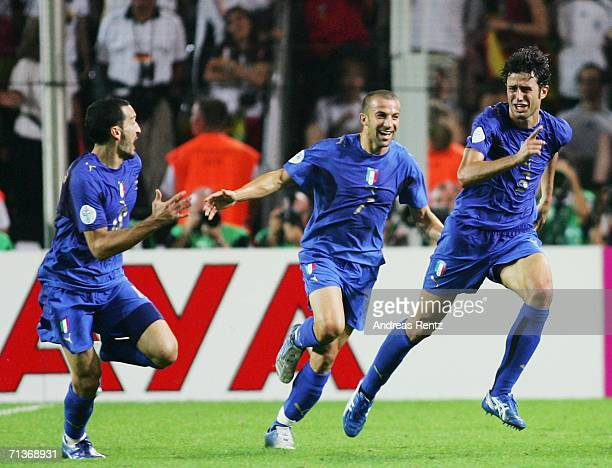 Fabio Grosso of Italy celebrates scoring his team's first goal in extra time with team mates Gianluca Zambrotta and Alessandro Del Piero during the...