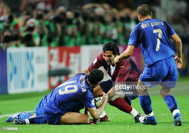 Fabio Grosso of Italy celebrates scoring his team's first goal in extra time with team mates Gianluca Zambrotta Gianluigi Buffon and Alessandro Del...