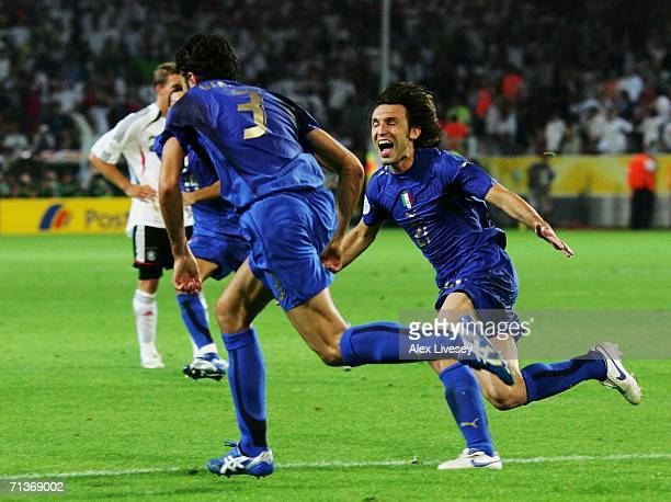 Fabio Grosso of Italy celebrates scoring his team's first goal in extra time with team mate Andrea Pirlo during the FIFA World Cup Germany 2006...