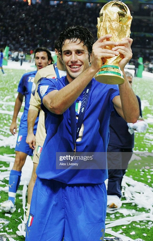 Fabio Grosso of Italy holds the World Cup trophy aloft following his team's victory in a penalty shootout at the end of the FIFA World Cup Germany 2006 Final match between Italy and France at the Olympic Stadium on July 9, 2006 in Berlin, Germany.