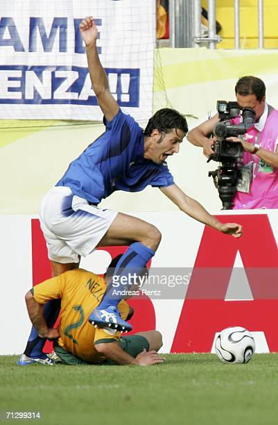 Fabio Grosso of Italy is brought down by Lucas Neill of Australia, to win his team the match winning penalty during the FIFA World Cup Germany 2006...
