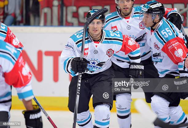 Fabio Hofer of the Black Wings Linz celebrates after scoring the 02 during the game between Duesseldorfer EG and Black Wings Linz on August 22 2015...