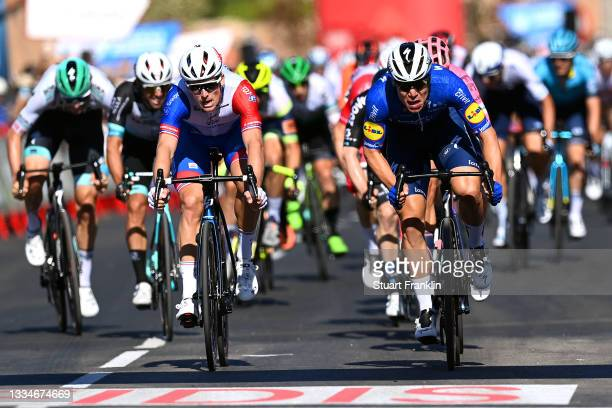 Fabio Jakobsen of Netherlands and Team Deceuninck - Quick-Step sprints to win ahead of Arnaud Demare of France and Team Groupama - FDJ during the...