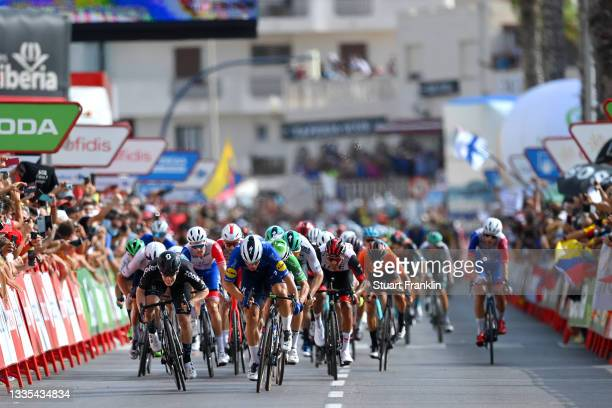 Fabio Jakobsen of Netherlands and Team Deceuninck - Quick-Step sprints to win ahead of Alberto Dainese of Italy and Team DSM and Jasper Philipsen of...