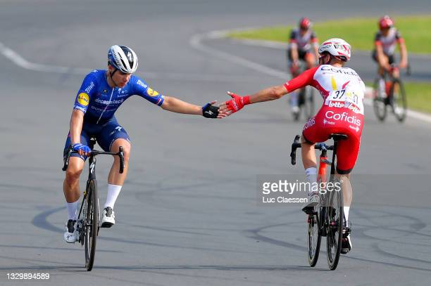 Fabio Jakobsen of Netherlands and Team Deceuninck - Quick-Step stage winner & Kenneth Vanbilsen of Belgium and Team Cofidis celebrates at arrival...