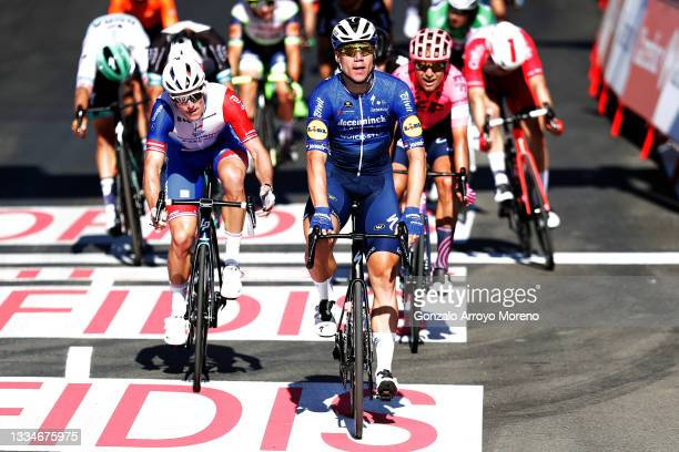 Fabio Jakobsen of Netherlands and Team Deceuninck - Quick-Step celebrates winning stage ahead of Arnaud Demare of France and Team Groupama - FDJ and...