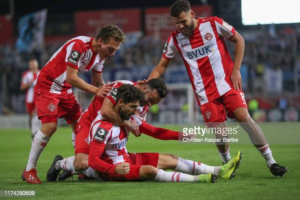 Fabio Kaufmann of FC Würzburger Kickers celebrates after scoring his team`s second goal with team mates during the 3. Liga match between FC...