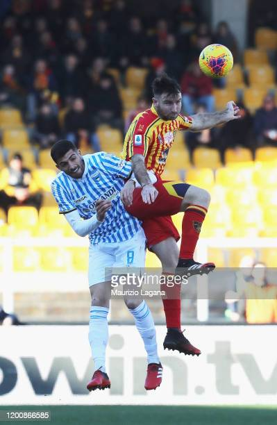 Fabio Lucioni of Lecce competes for the ball in air with Mattia Valoti of Spal during the Serie A match between US Lecce and SPAL at Stadio Via del...