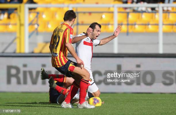 Fabio Lucioni of Lecce competes for the ball with Goran Pandev of Genoa during the Serie A match between US Lecce and Genoa CFC at Stadio Via del...