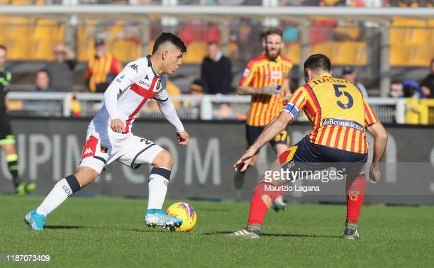 Fabio Lucioni of Lecce competes for the ball with Kevin Agudelo of Genoa during the Serie A match between US Lecce and Genoa CFC at Stadio Via del...