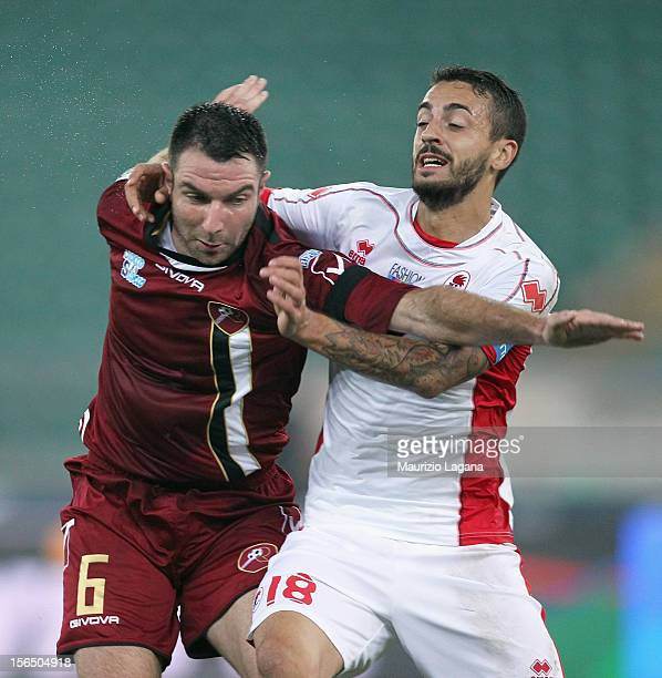 Fabio Lucioni of Reggina and Francesco Caputo of Bari in action during the Serie B match between AS Bari and Reggina Calcio at Stadio San Nicola on...