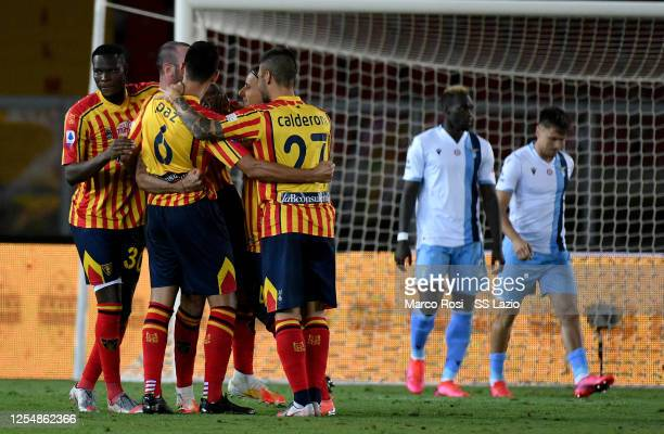 Fabio Lucioni of UC Lecce celebrates after scoring the second goal of his team with his team mates during the Serie A match between US Lecce and SS...