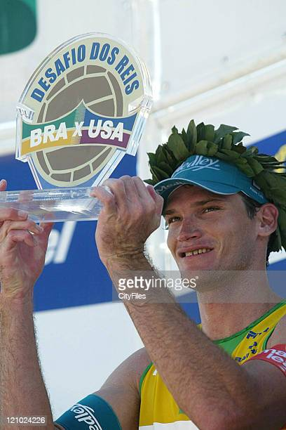 Fabio Luiz and Marcio of Brazil receiving trophy after a match against Todd Rogers and Phil Dalhausser of the United States during the Desafio dos...
