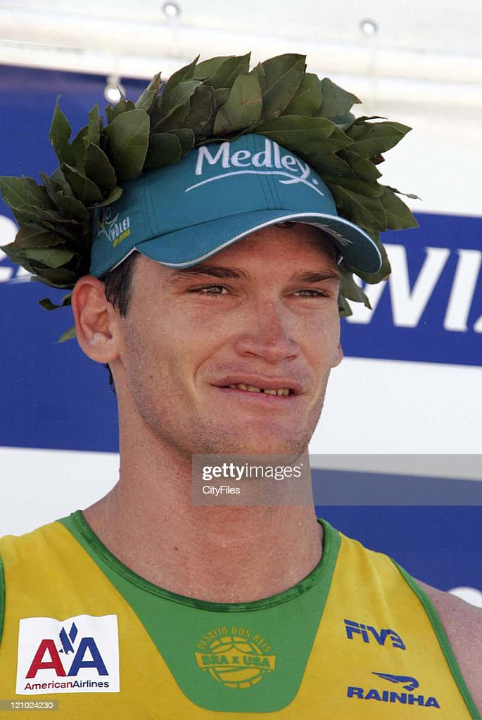 Fabio Luiz and Marcio of Brazil receiving trophy after a match against Todd Rogers and Phil Dalhausser of the United States during the Desafio dos Reis (Kings tournament) held at Ipanema Beach in Rio De Janeiro, Brazil on February 18, 2007. Fabio Luiz and Marcio won the competition.