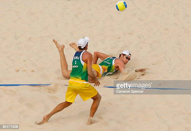 Fabio Magalhaes and Marcio Araujo of Brazil dive for the ball during the men's semifinal beach volleyball match against Brazil at the Chaoyang Park...