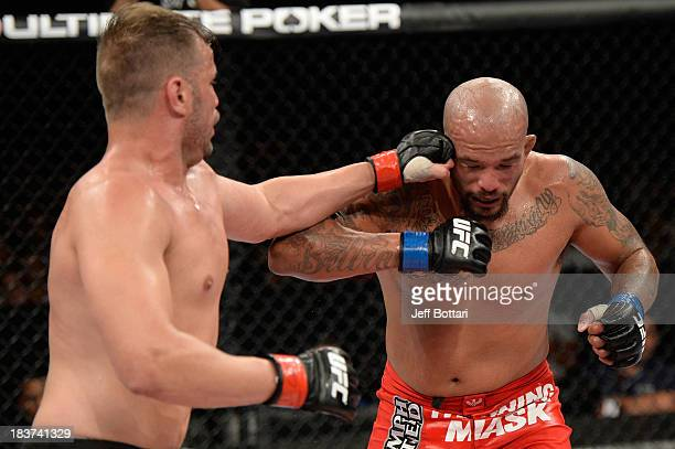 Fabio Maldonado punches Joey Beltran in their light heavyweight bout during the UFC Fight Night event at the Ginasio Jose Correa on October 9, 2013...