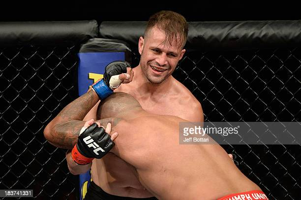 Fabio Maldonado smiles while fighting against Joey Beltran in their light heavyweight bout during the UFC Fight Night event at the Ginasio Jose...