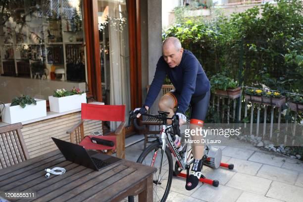 Fabio Martinelli, a cyclist trains indoors with a bike home trainer to avoid leaving his apartment on March 11, 2020 in Rome, Italy. The Italian...