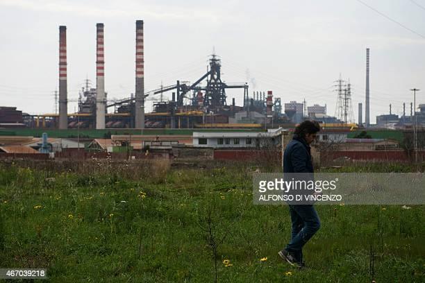 IDE Fabio Matacchiera ecologist who denounces pollution of the Ilva steel plant walks in a field on March 18 2015 in Taranto The site in Taranto in...