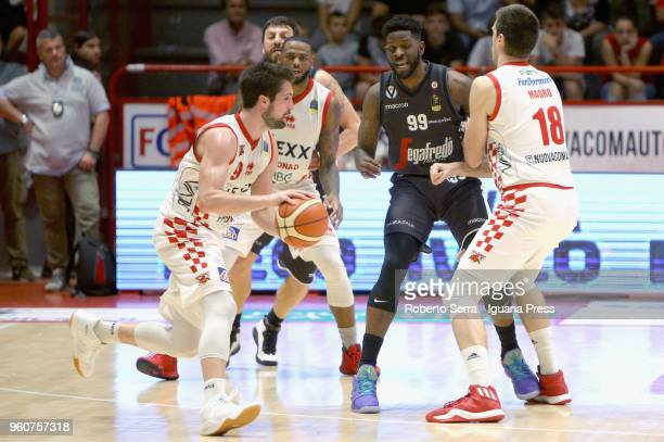 Fabio Mian and Jaylen Bond and Daniele Magro of The Flexx competes with Klaudio Ndoja and Jamil Wilson of Segafredo during the LBA LegaBasket match...