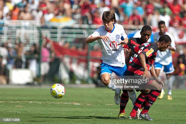 Fabio of Bahia struggles for the ball with Alex of Flamengo during the final match of Sao Paulo Juniors Cup 2011 at Pacaembu Stadium on January 25...